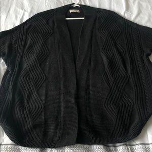 Cozy, gently worn black cardigan